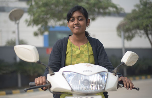 Indian girl riding a Hero MotoCorp motorcycle