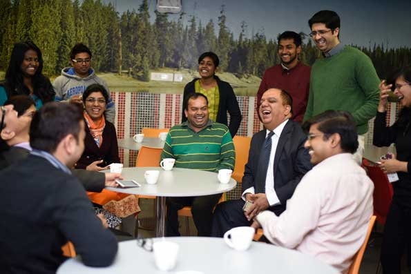 Vijay Sethi, CIO of Hero MotoCorp laughs and enjoys an informal meeting with his colleagues