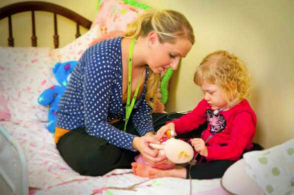 Pediatric Home Service nurse providing an in-home patient health care to a little girl